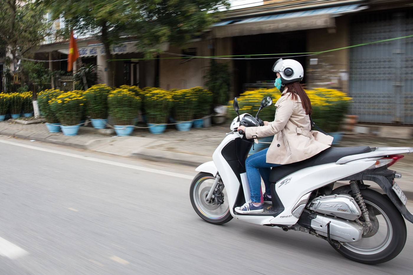 Girl on a Motorbike