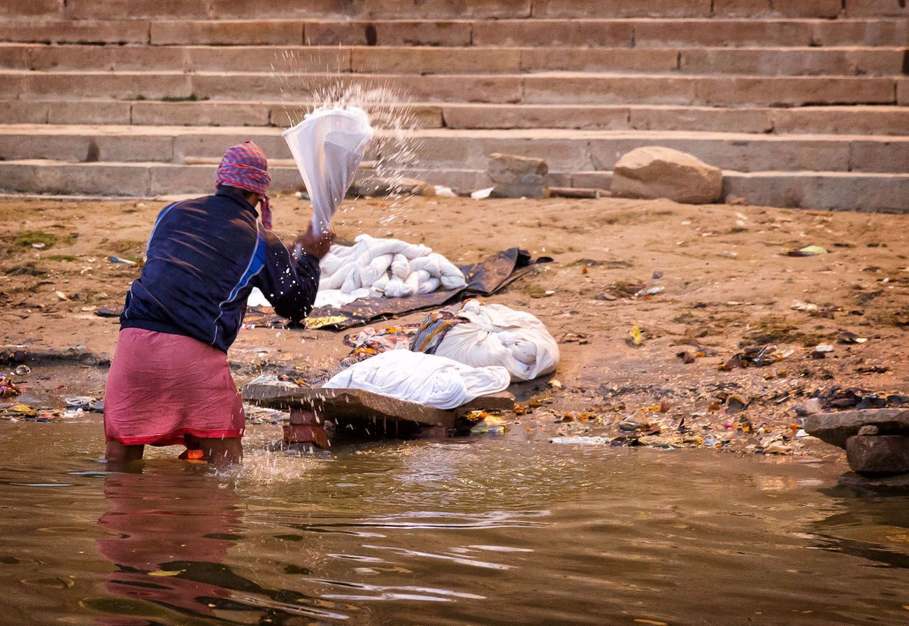 Doing laundry in the Ganges River Varanasi