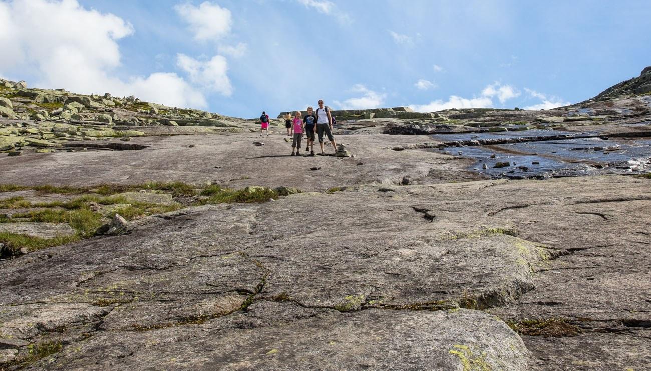Granite face climb of Trolltunga