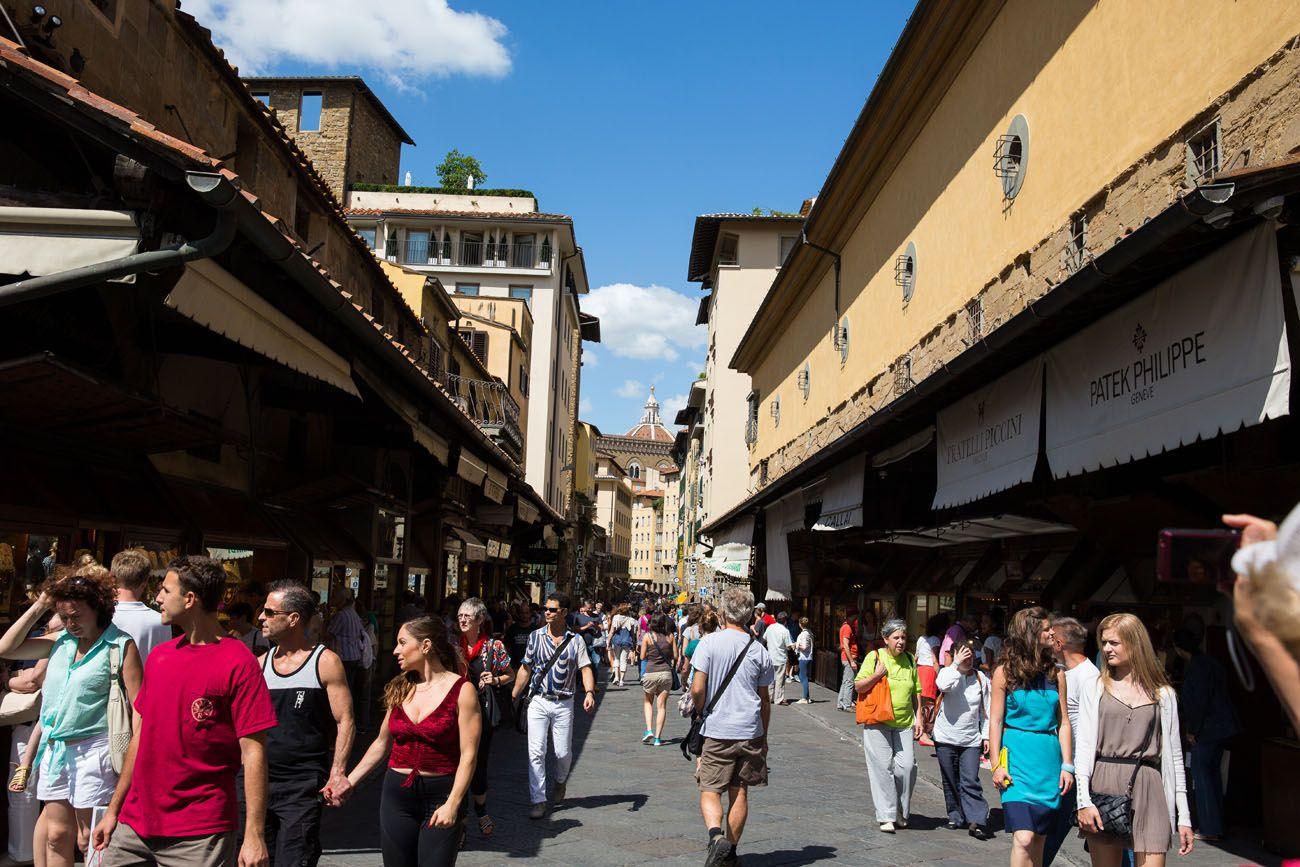 Walk across Ponte Vecchio