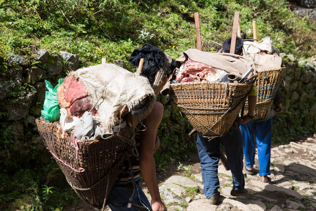 Porters carrying meat